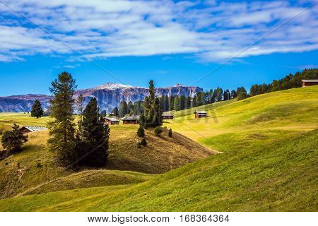The Alps di Siusi. Well-known international ski resort in the fall. Concept of active and ecological tourism. Jagged rocks around the Dolomites mountain valley