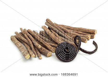 Liqorice roots and black wheel on white background