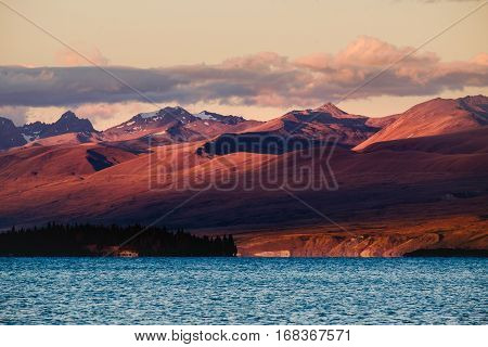 Landscape View Of Lake Tekapo Mountains At Dramatic Sunset