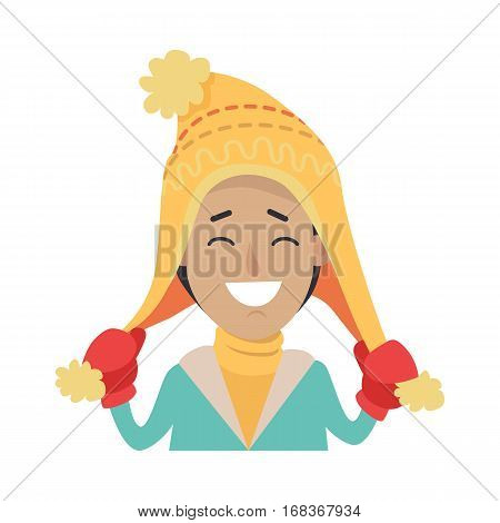Hat. Happy smiling boy with yellow cap on head. Male holding endings of hat in two hands in red mittens. Knitted hat with stripes. Yellow sweater. Green jacket. White background. Vector illustration