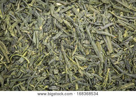 background texture of loose leaf Sencha Saga  green tea