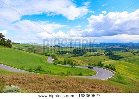Road Rural Landscape Of Tuscany And Green Rolling Hills Near Volterra