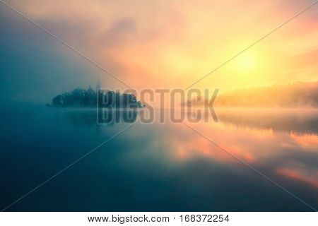 Beautiful misty sunrise morning in lake Bled-Slovenia