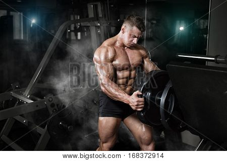Bodybuilder Muscle Athlete Training With Weight In Gym