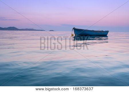 Lonely traditional greek fishing boat on sea water Zakynthos island Greece