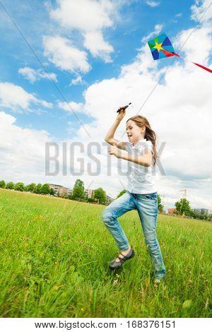 little girl flying a kite. some motion blur