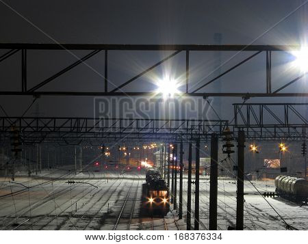 railway station covered with snow against the sky