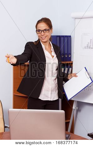 Woman In Suit With A Clipboard In The Hand