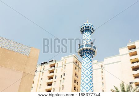 minaret of a mosque in a residential district of dubai