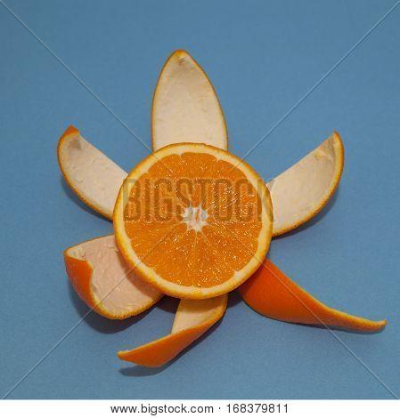 One Nice Peeled orange on blue background