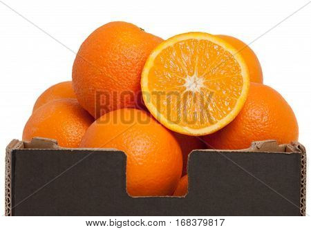 Nice fresh raw oranges in brown box isolated on white