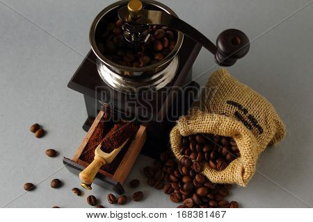 Grinding coffee beans with old hand mill