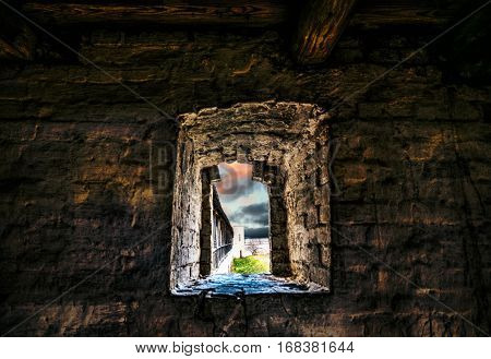 window in a medieval dungeon overlooking freedom