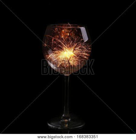 Wine Glass With A Sparkler. In Anticipation Of New Year And Christmas