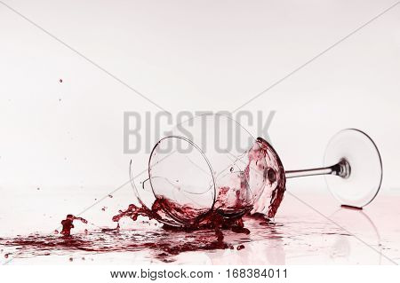 Broken Wineglass On The Table. Poured Red Wine, Like Blood.