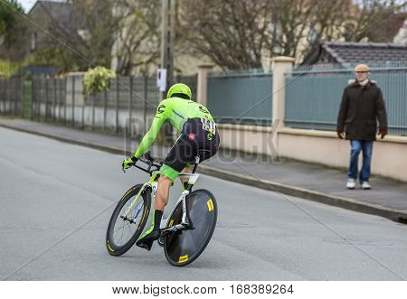 Conflans-Sainte-HonorineFrance-March 62016: The French cyclist Pierre Rolland of Cannondale Team riding during the prologue stage of Paris-Nice 2016.