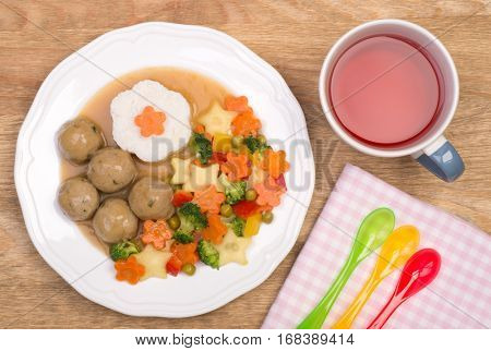Meatballs with vegetables and rice, cute dinner for a child