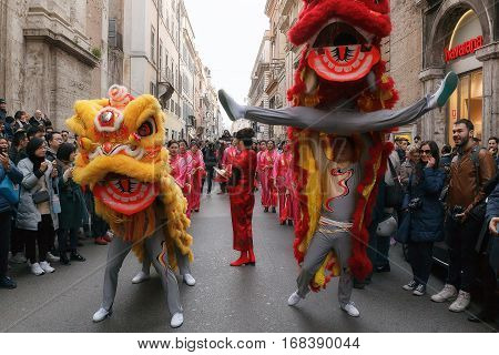 Rome Italy - January 28 2017: Celebration of the Chinese New Year in Rome the year of the rooster. Procession with dragons and female musicians bongo