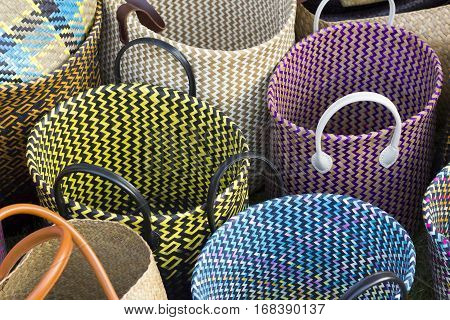 Straw shopping bags different size on grass