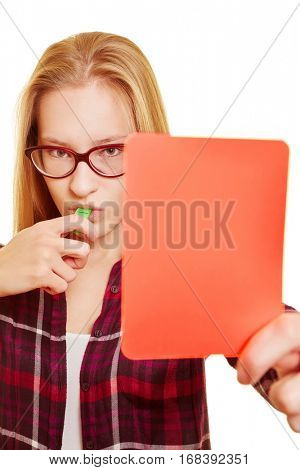 Young woman with a whistle shows a red card as a warning
