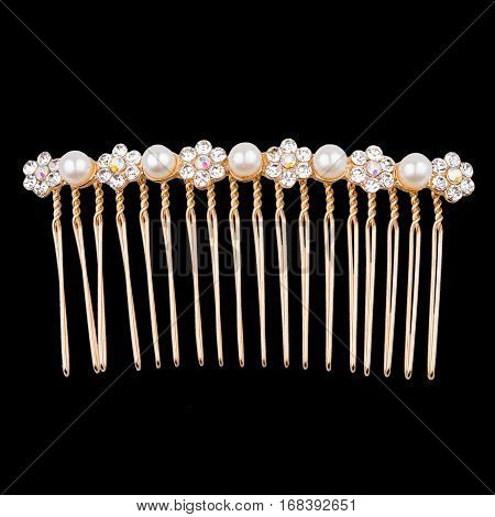 golden Hair Comb with diamonds and pearl on black background