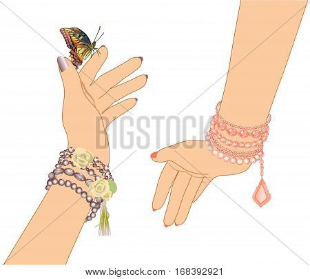 woman's hands with bracelets of beads and a butterfly on white background