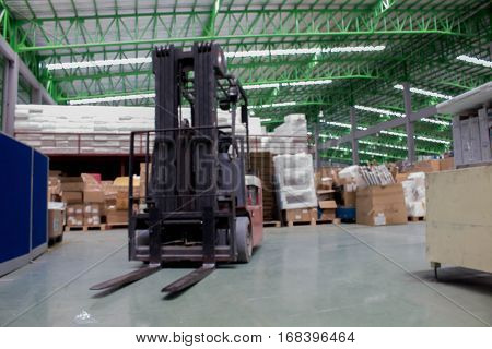small forklift in the warehouse (Blur picture)