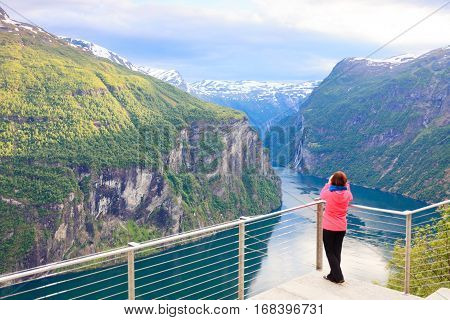 Tourist Looking At Geirangerfjord From Flydasjuvet Viewpoint Norway