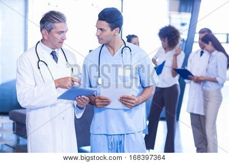 Doctor examining medical report and having a discussion in hospital