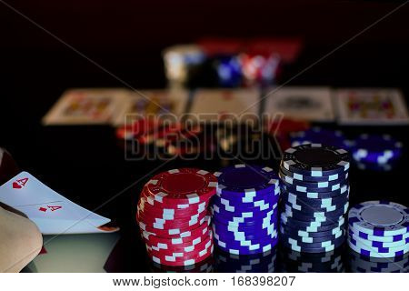 Playing Texas hold'em. Poker player has pair of aces in pocket pair and lots of chips.