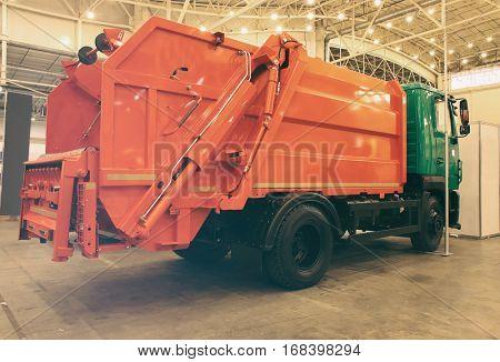 Garbage truck in garage