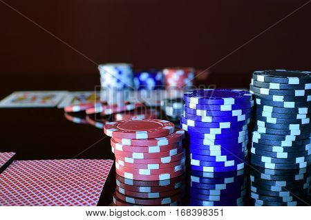 Poker Chips on a gaming table. Surface with reflection.
