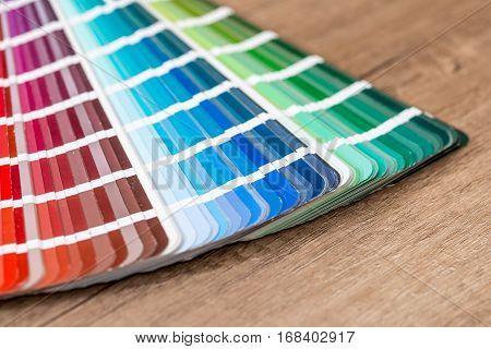 Color chart guide on deks close up