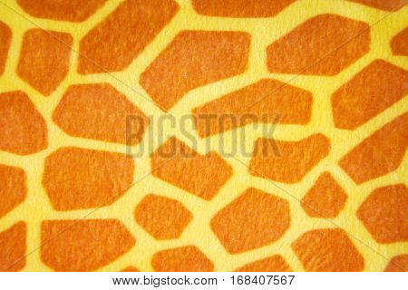 Fabrics with the drawing under a skin of a giraffe background
