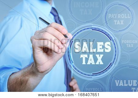 Man pushing SALES TAX button on virtual screen. Taxation concept