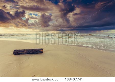 Beatiful Sunset With Clouds Over Sea And Beach