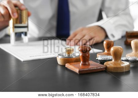 Wooden and metal stamps on notary public table