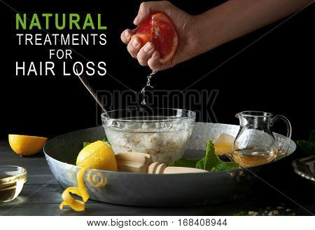 Woman preparing cosmetic product for hair care. Text NATURAL TREATMENTS FOR HAIR LOSS on dark background