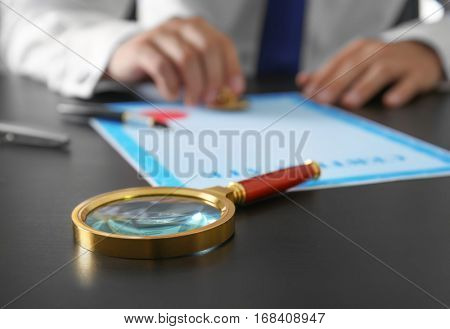 Magnifier on notary public table