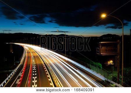 Light trails of evening highway