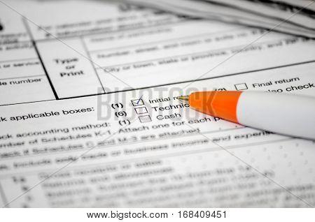 TAX form W - 4 pen close up