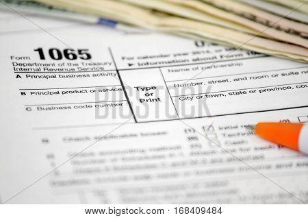 Tax forms 1065 dollar pen close up