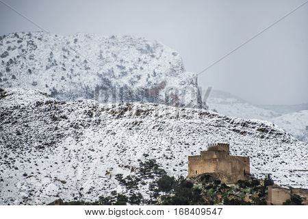 Castle of Petrer / Petrel Alicante, Spain, after a historic snowfall poster