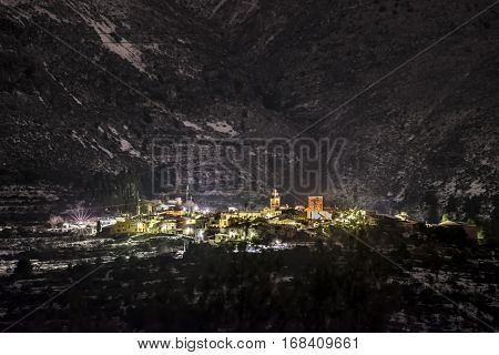 Almudaina from Planes, at night, after an historical snowfall. poster