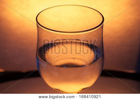 A Glass Of White Wine On A Bright Yellow Background,