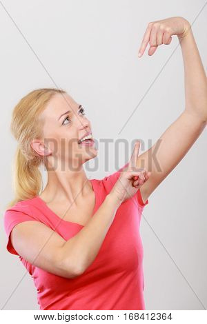 Happy Woman Pointing On Right Side