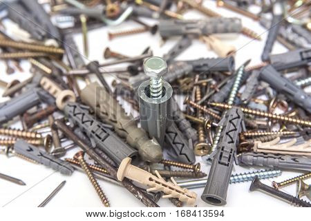 hardware items. Dowel and screw close up