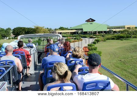 Cayo Coco Cuba 16 january 2016 - people on a touristic bus in the park of hotel Tryp Coco on Cayo Coco Cuba