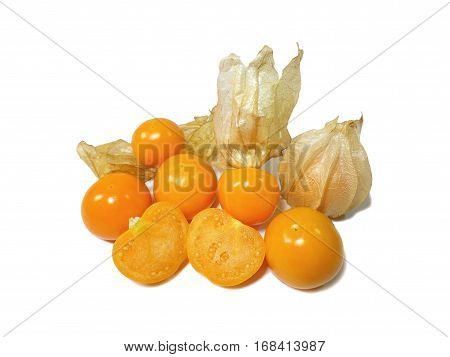 Bunch of vivid yellow ripe Cape gooseberries, some with calyx, some whole, some cut in half isolated on white background