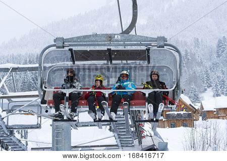ALTAUSSEE AUSTRIA - JANUARY 11 2017 : Family Skiers on Ski Lift. Winter Holiday In Mountains.